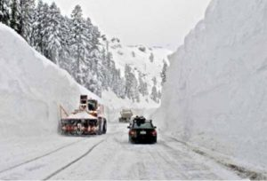 Snowy highway with snow plow