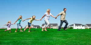 Family running on grass