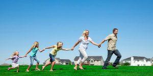 Family running on grass