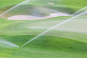Golf course with sprinklers on